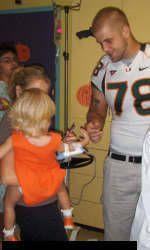 Coker, Players Visit Miami Children's Hospital