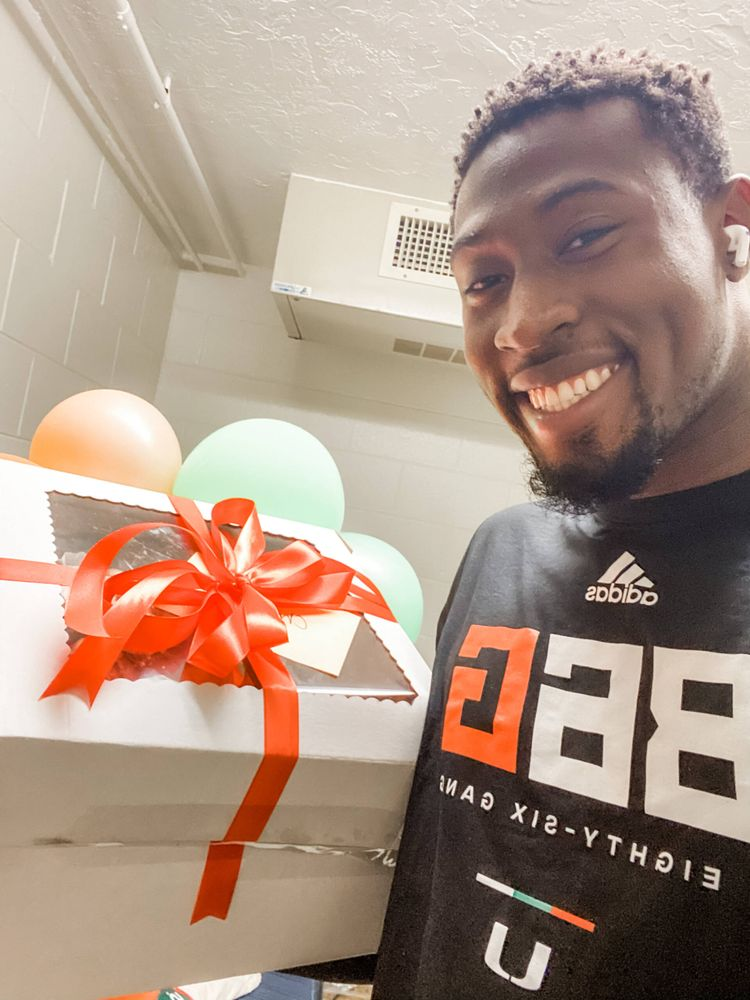 Hurricanes defensive end Chantz Williams with treats baked by Marianne Stroud, the wife of defensive line coach Todd Stroud.